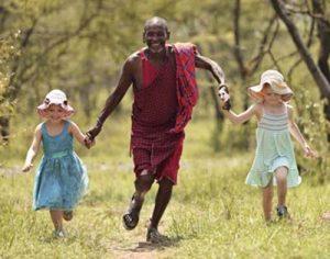 Naboisho-Camp-guide and-children-running-Stevie-Mann-3